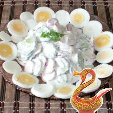 Russian salad of radish and cucumber with egg