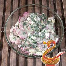 Russian salad with ham and radish